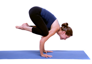 This is Crow Pose. That is NOT me in Crow Pose.