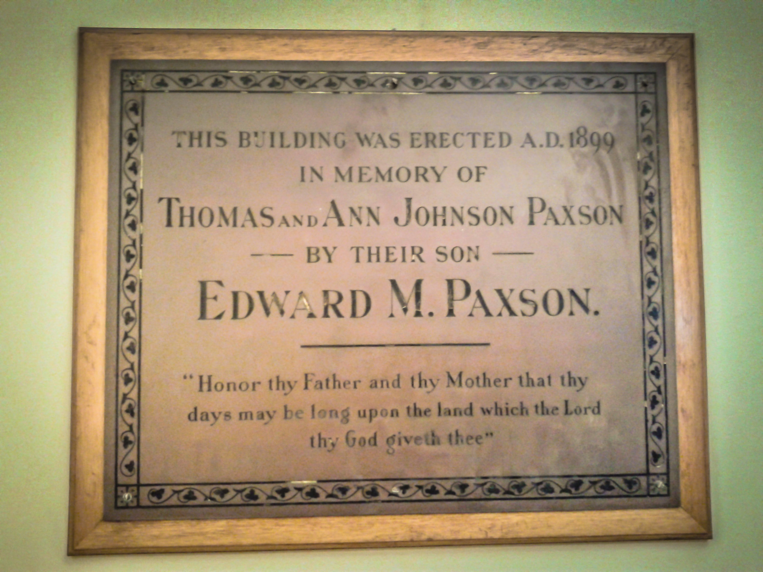 brass plaque hanging in paxson hall, fhv's personal care building.