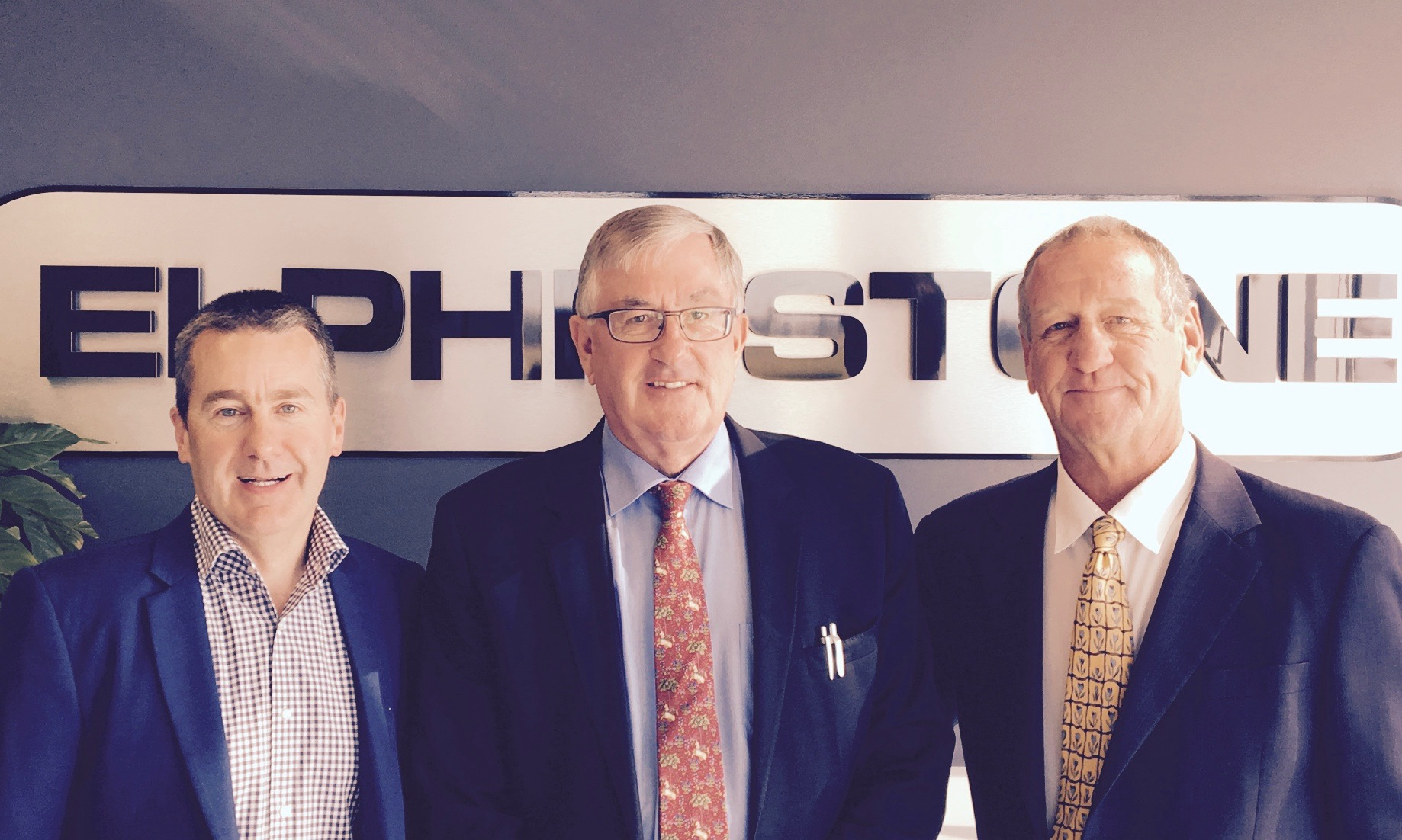 Elphinstone's executive general manager Lee Whiteley, Tasmanian transport minister Rene Hidding and Transit Australia Group chairman Luke Gray