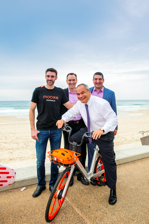 City of Gold Coast mayor Tom Tate trials bike-share, with (L-R)Mobike's Chris Martin, TAG's Michael McGee and Good Cycles Jaison Hoernel