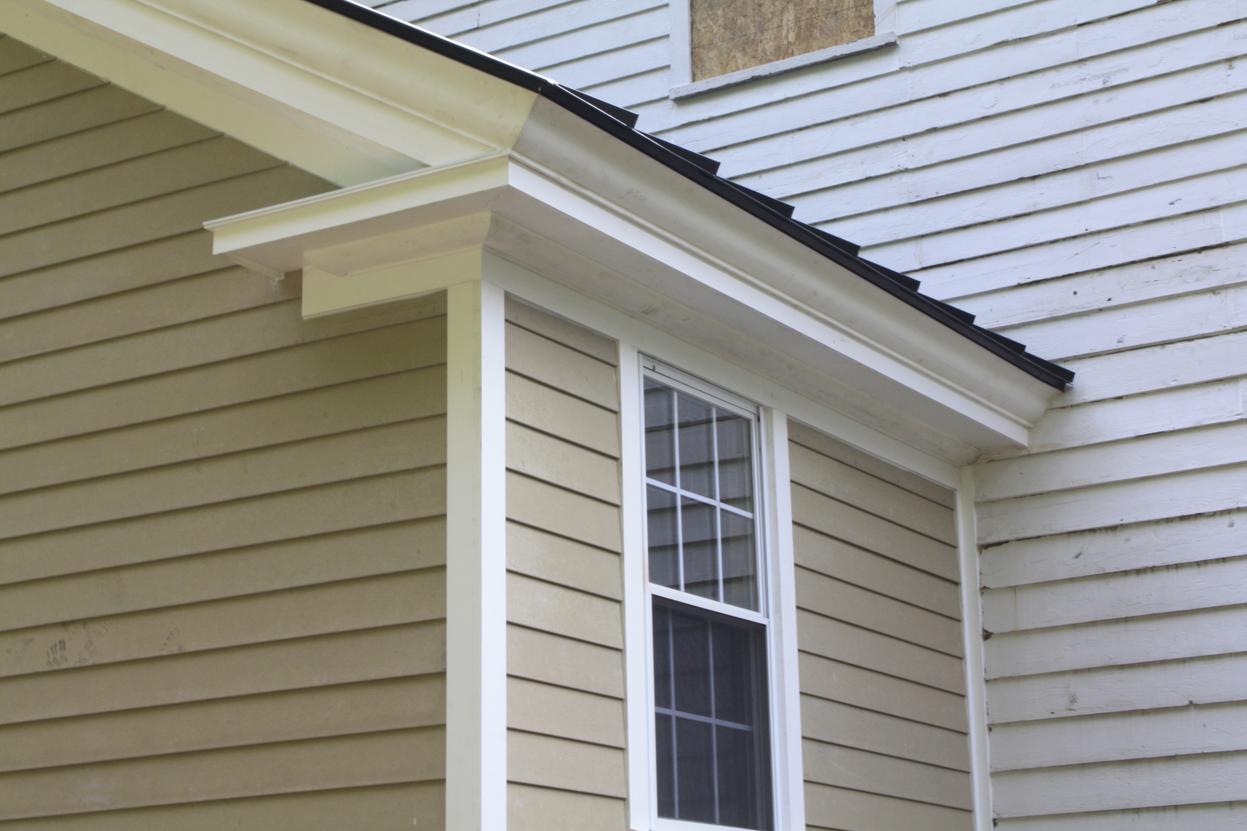 CORNICE DETAIL AND METAL ROOFING