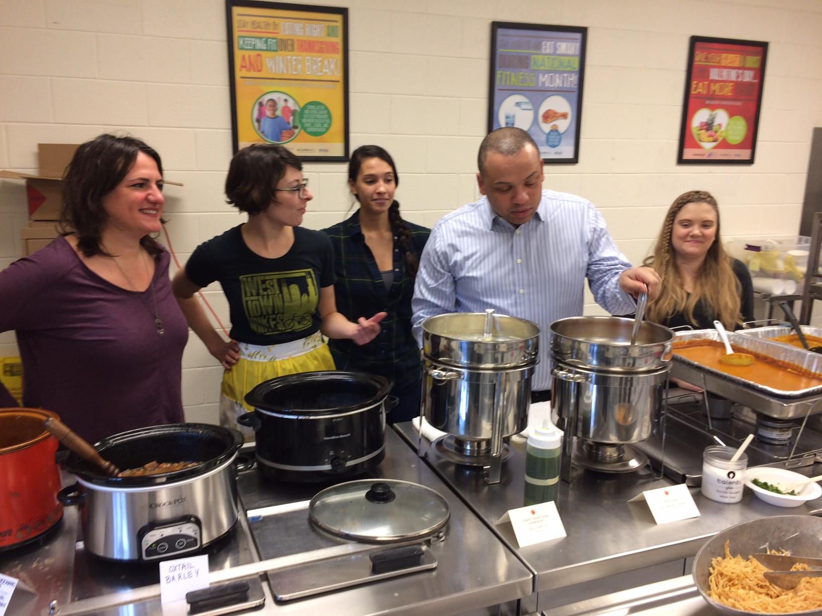 City Treasurer Kurt Summers joins the soup serving line.