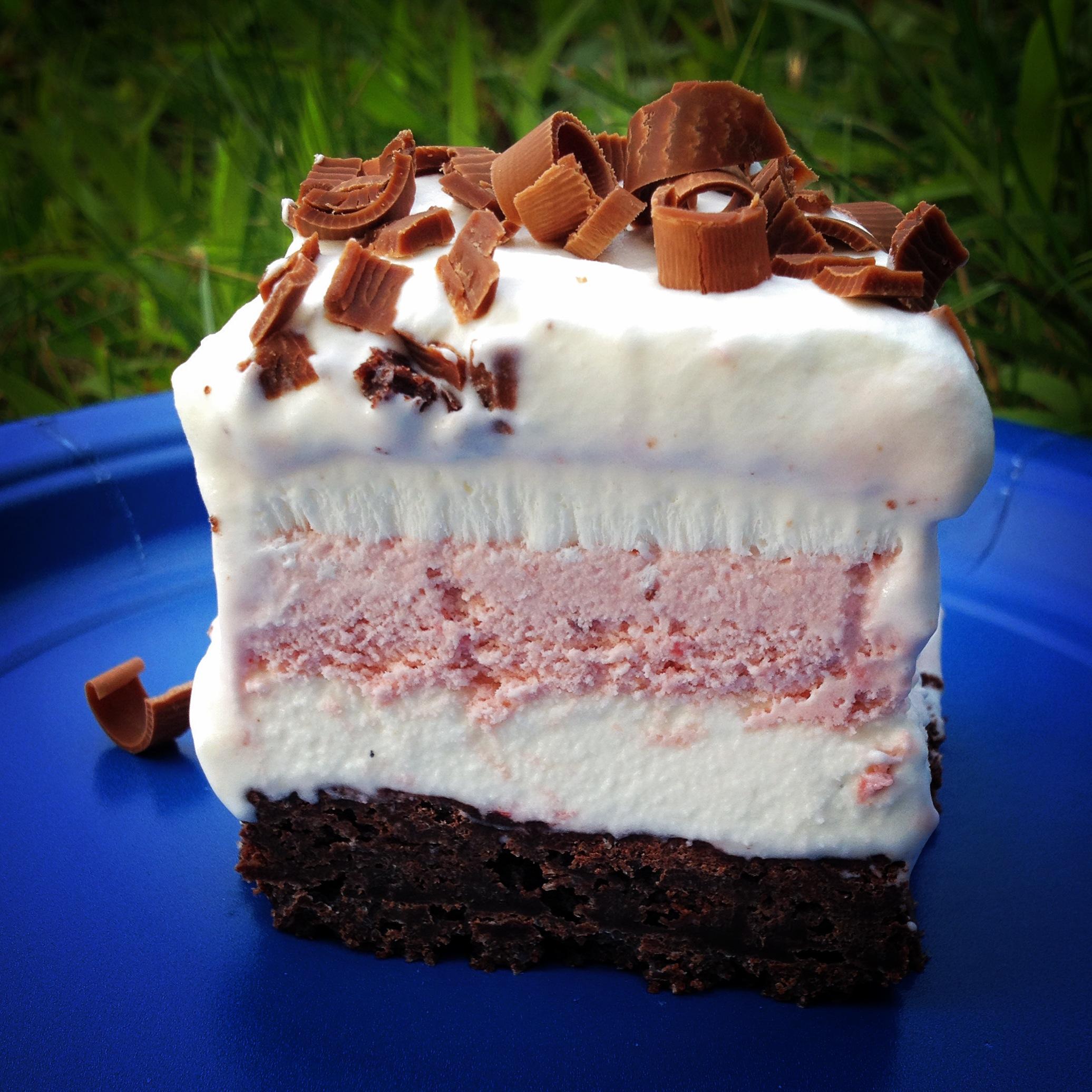 ice cream cake: balsamic roasted strawberry ice cream vanilla bean ice cream sourdough brownie crust whipped cream topping with milk chocolate curls