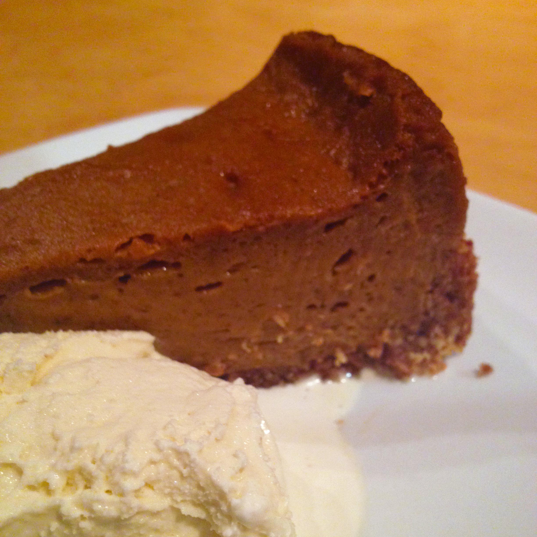 vegan pumpkin pie with a coconut hazelnut crust cinnamon ice creamn