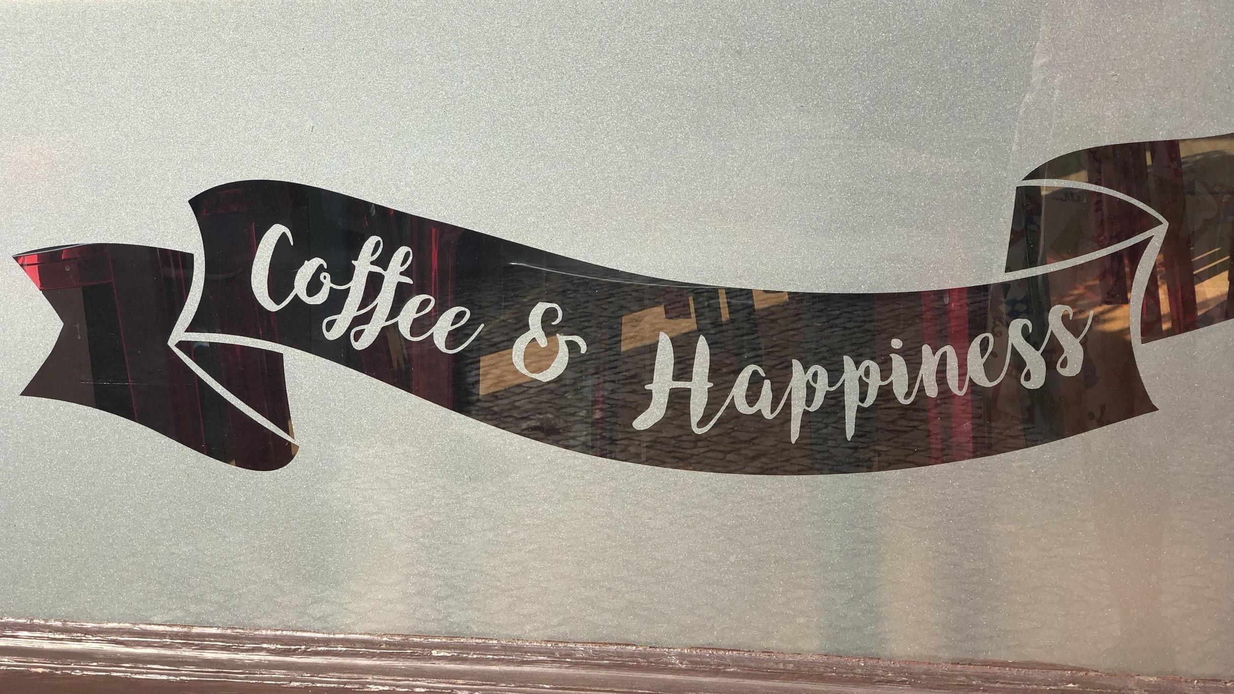 Schriftzug Coffee and Happiness Work-Life-Balance Maßnahmen