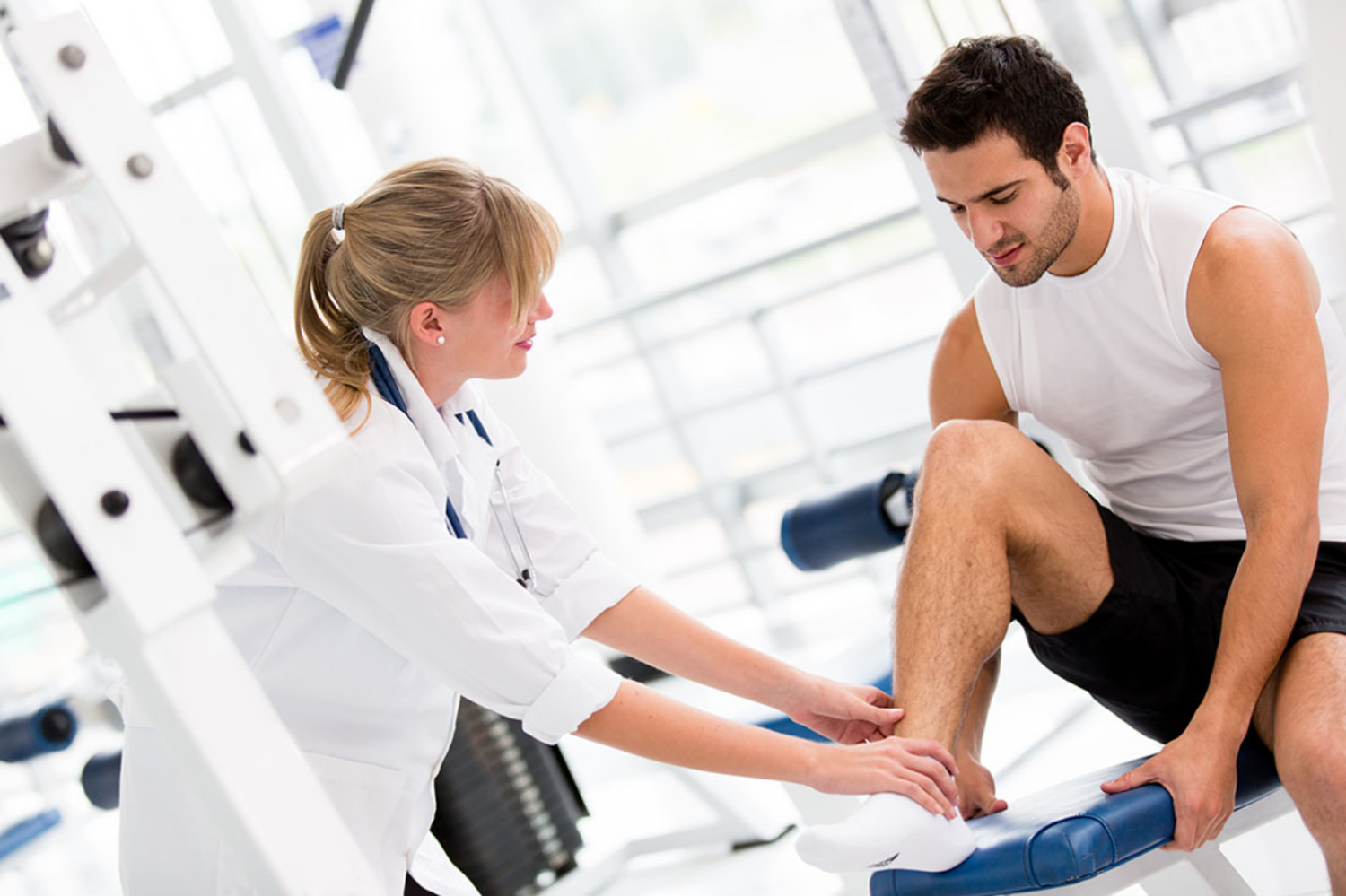 Male-getting-ankle-examined.jpg