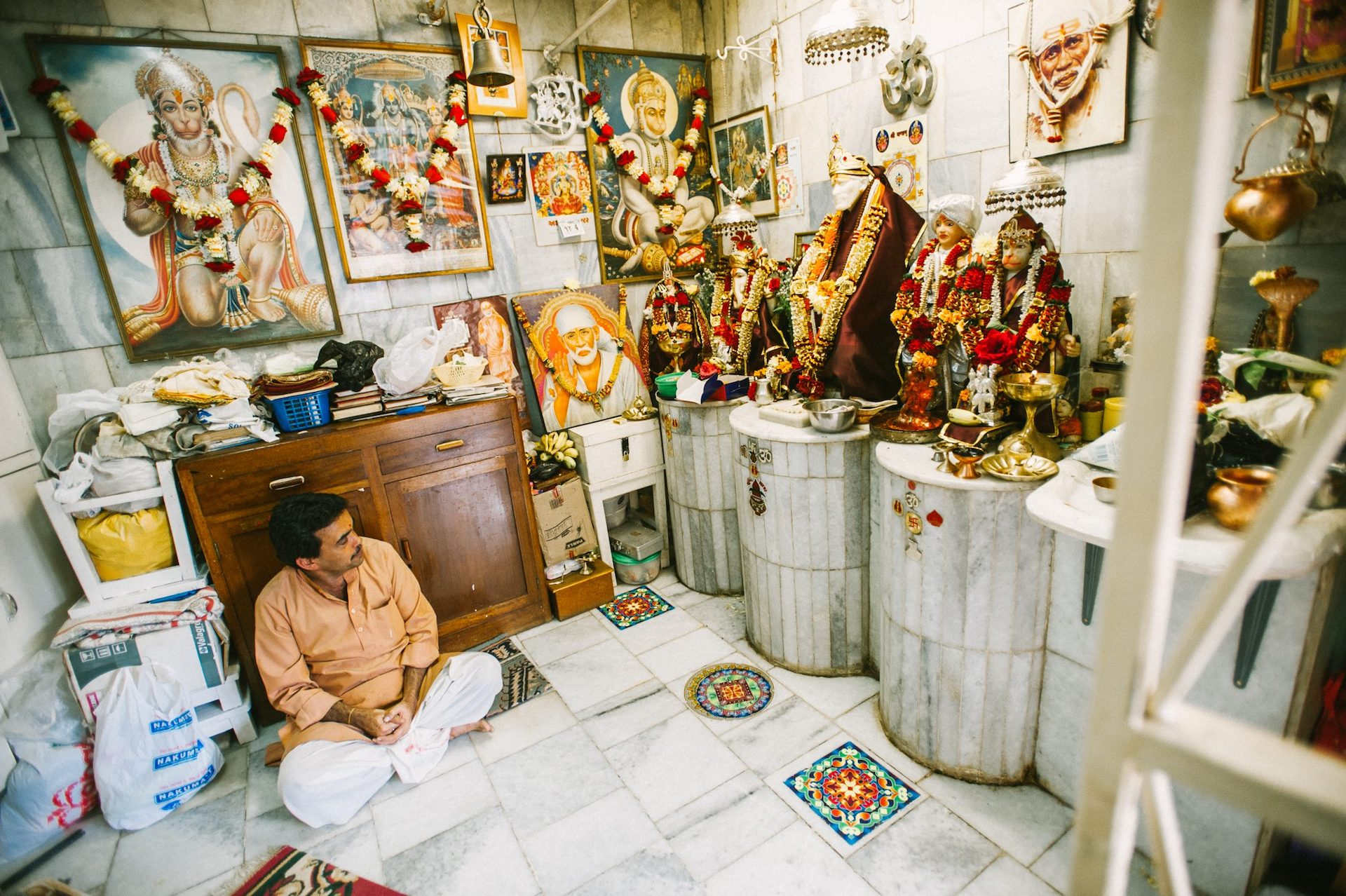 A Hindu sits in his idol shop in Kenya. He sells images of Hindu gods to Nairobi's Hindu population of 600,000 people. Photo from IMB Photo Library.