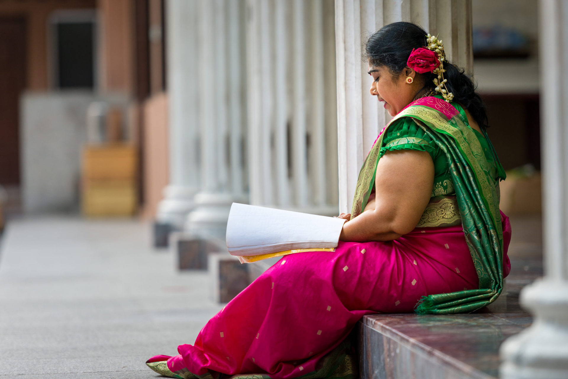 An Indian woman reads Hindu scripture at a temple in Malaysia. Photo from the IMB Photo Library.