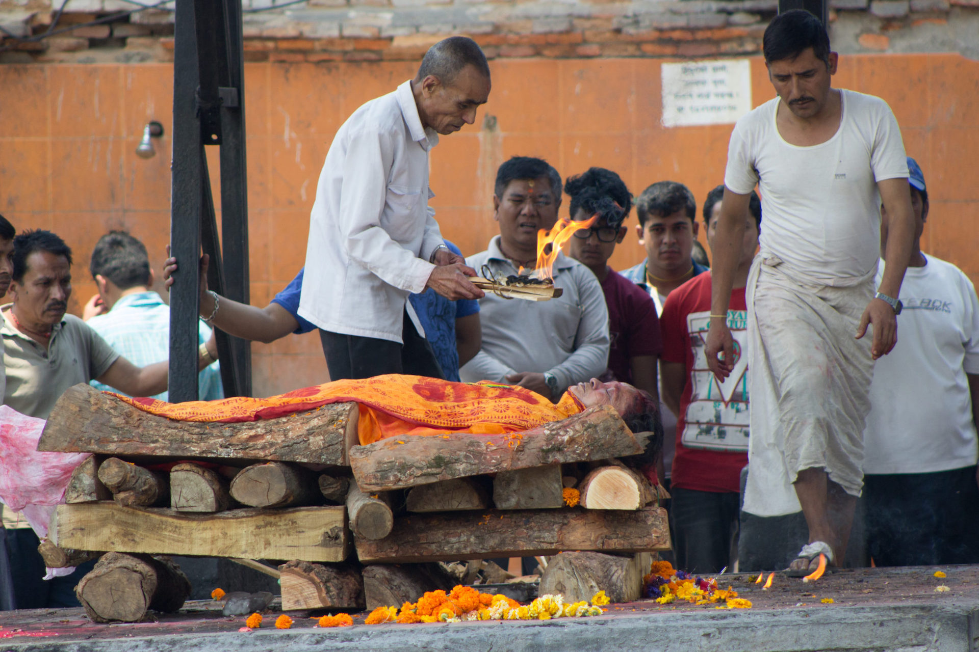 A man prepares to light a cremation pyre on fire at Pashupatinath Temple in Kathmandu, Nepal. Photo from the IMB Photo Library.