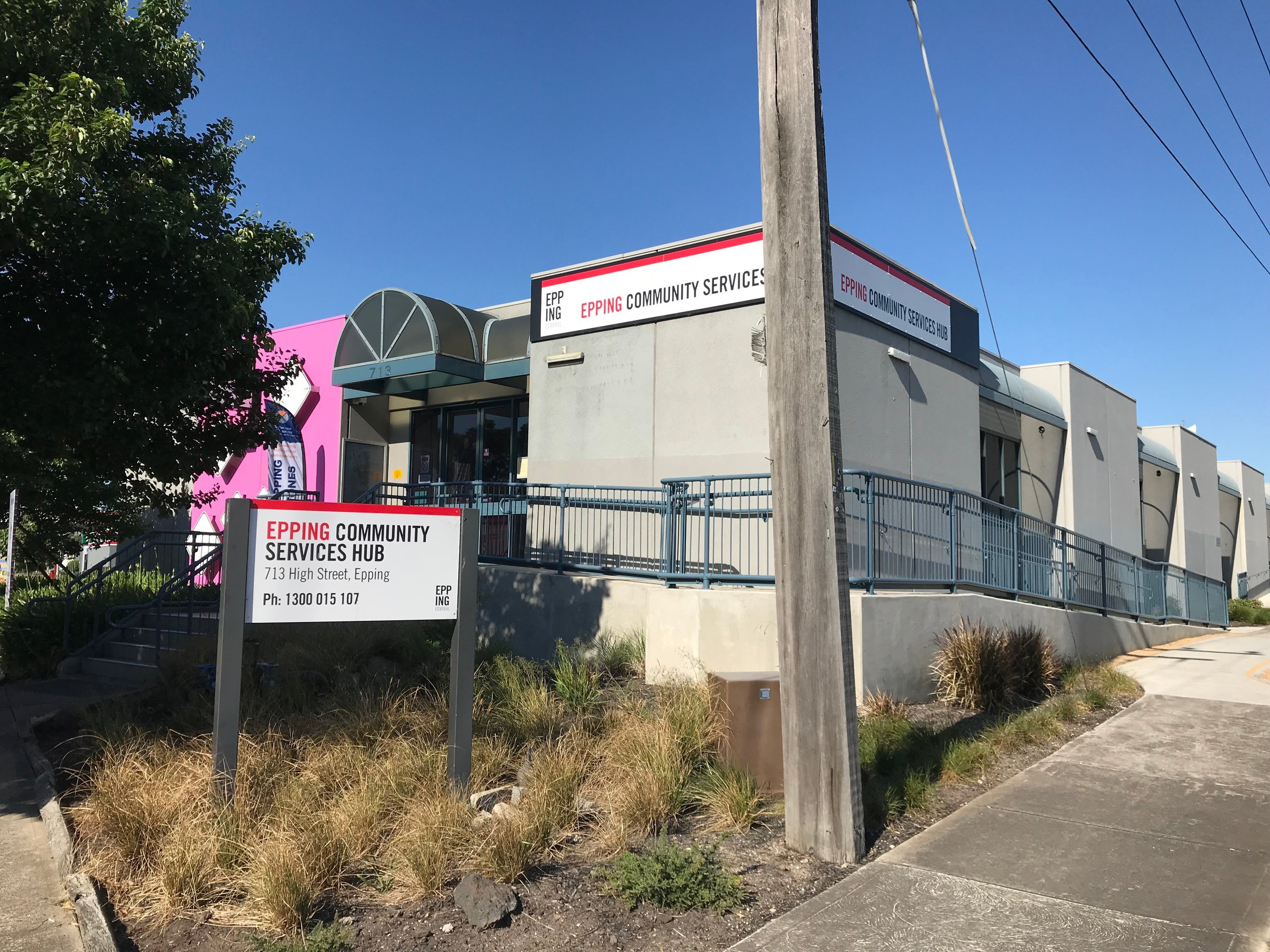 The Epping Community Services Hub is housed in a former Centrelink building, sold to Council for a discounted rate based on a good will agreement that it would be used for community uses. The bright pink exterior wall ensures that everyone that passes by is aware of the hub.
