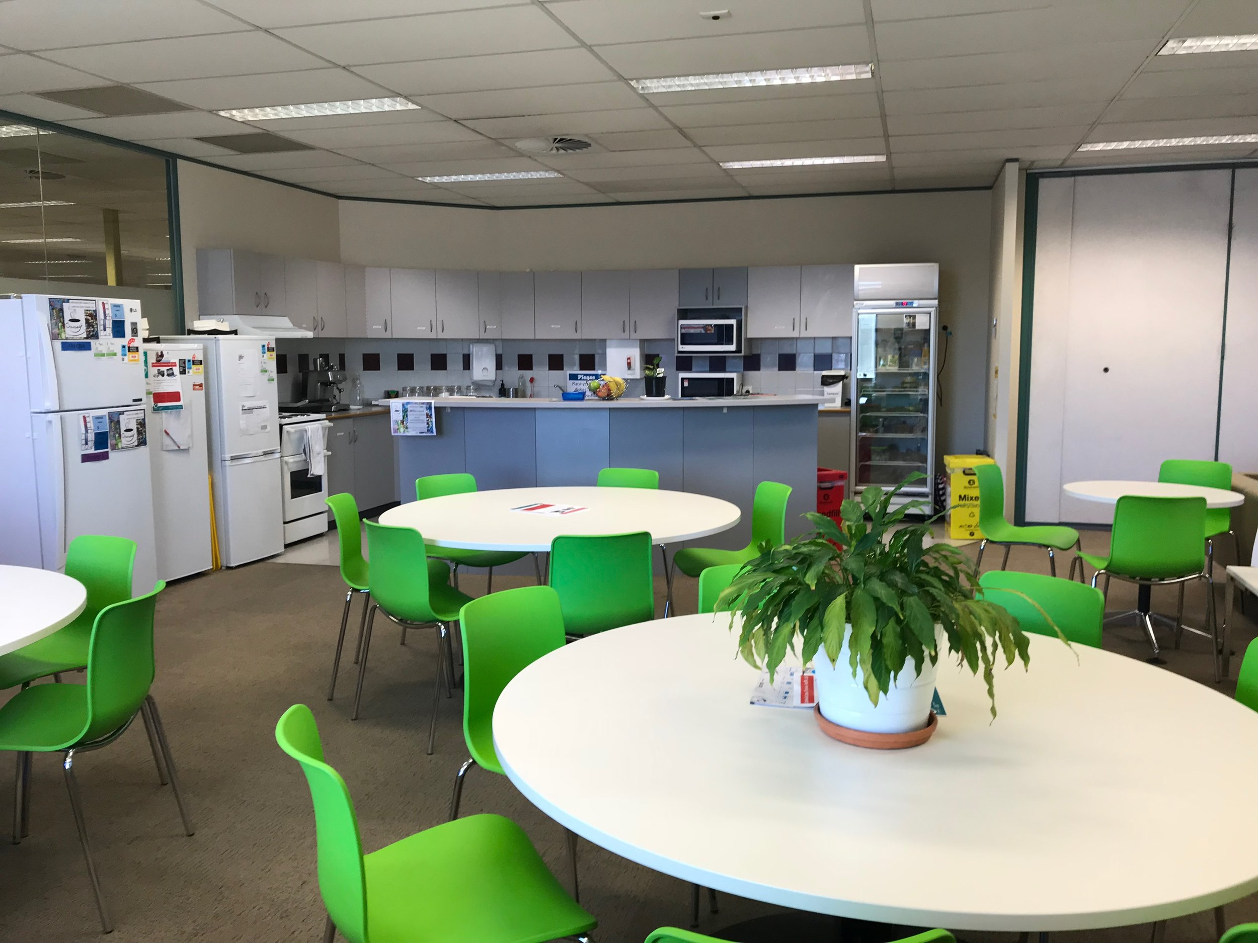 """The common room/kitchen is naturally lit, with plenty of spaces, a good kitchen, and a """"meet the hubsters"""" board."""