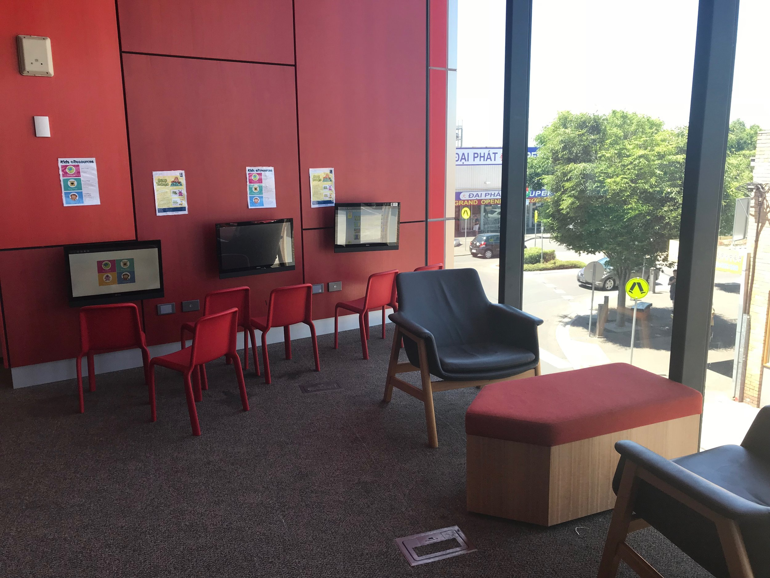 The children's area in the library includes children's computers, seating areas and an area for story time events.