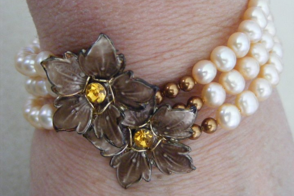"I created this ""Heirloom"" bracelet for my daughter.  The flowers at the centre were clip on earrings that had belonged to her Grandmother.  A lovely keepsake."