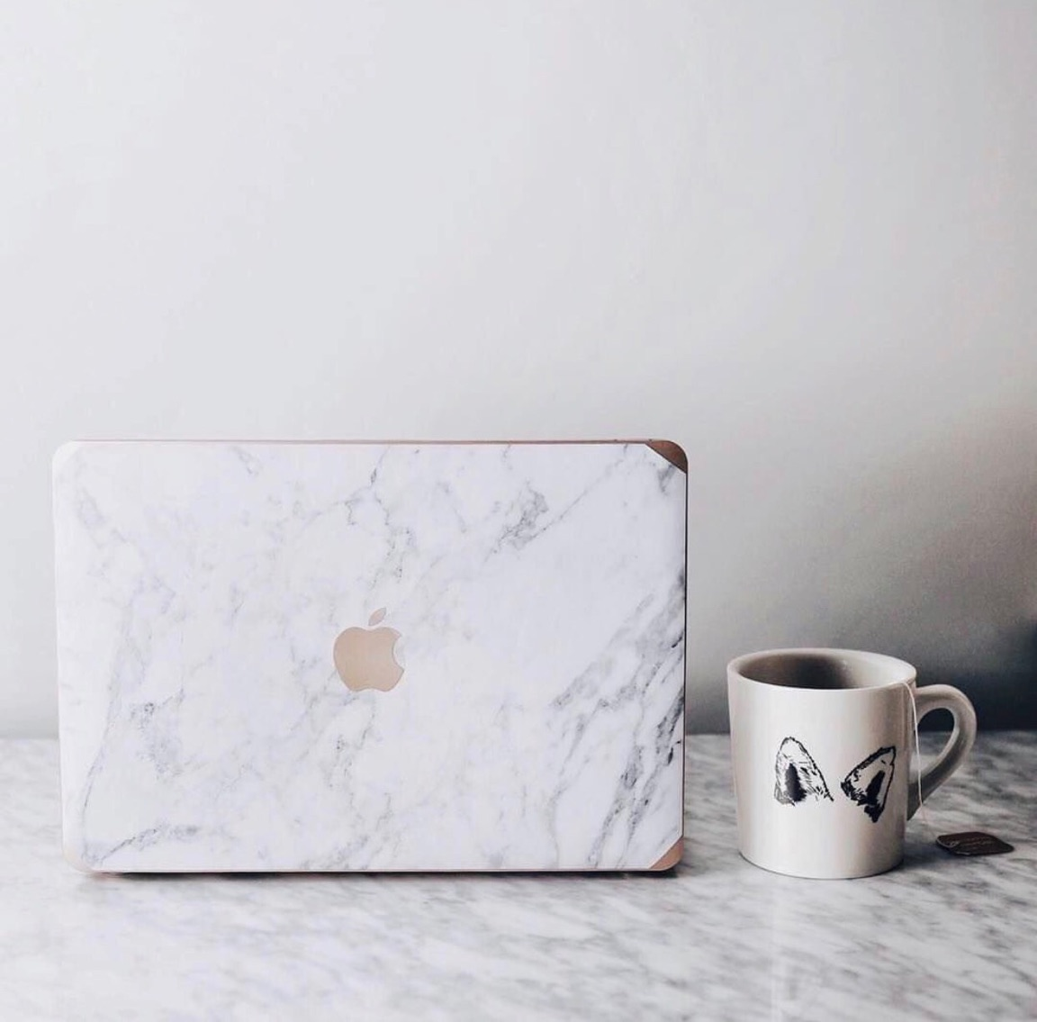 A Janet Gwen Designs Grey Marble Laptop Case - Show your Macbook® some love with a Janet Gwen Designs marble case. Simple, timeless, and (seriously) chic, this practical design is bound to turn a few heads. With easy-to-use snap-on grips and a dirt & scratch-proof design, this two-piece set is more than just a pretty face; its lightweight and durable design is made to withstand the typical wear and tear of the on-the-go lifestyle of a girl-boss, toting it here, there and everywhere.