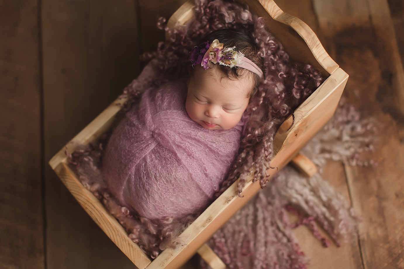 orange-county-newborn-photography-studio-organic-purple-cradle-beautiful-baby-girl.png