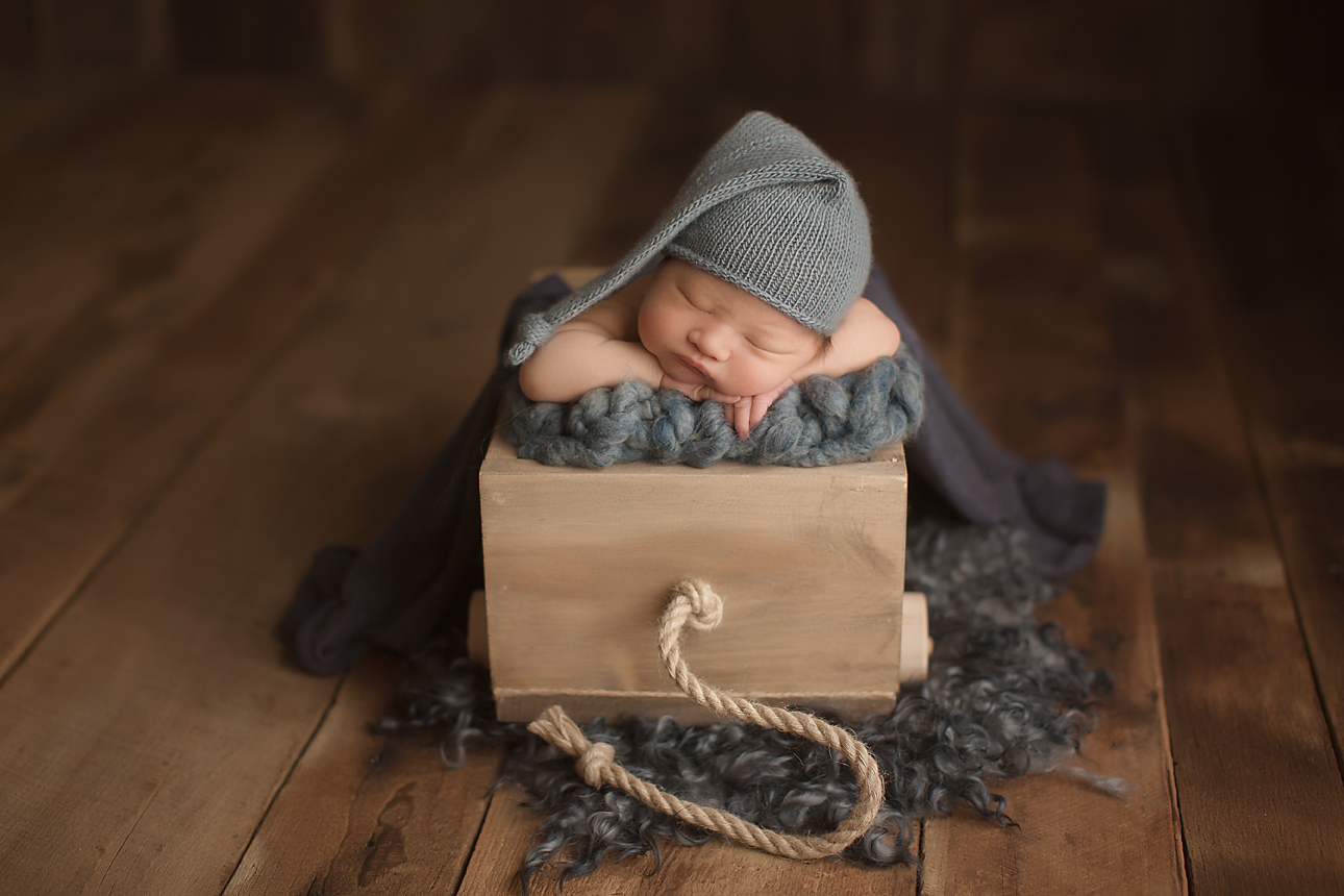orange-county-newborn-photography-studio-baby-boy-blue-wagon-blanket-organic.png