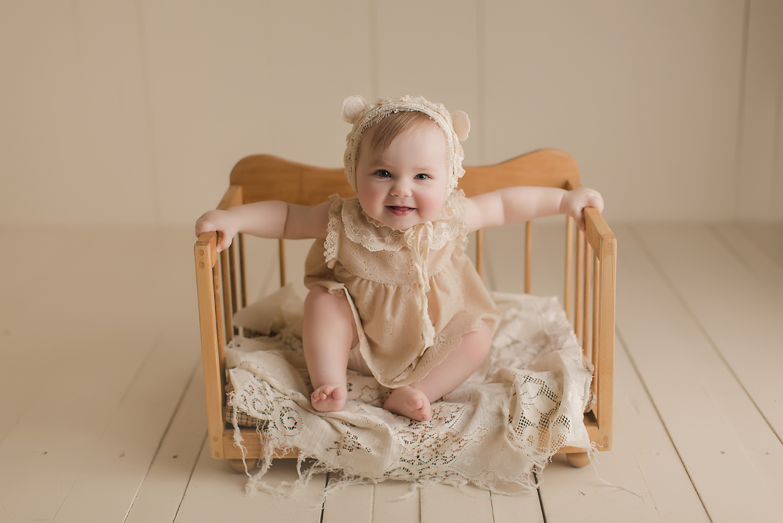 orange-county-baby-photography-studio-sitting-up-vintage-retro-crib.jpg