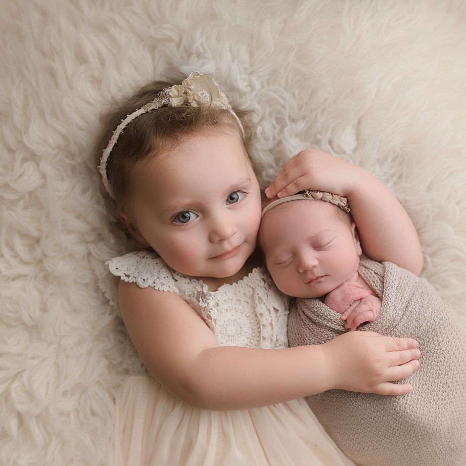 orange-county-newborn-photographer-irvine-studio-siblings-sisters-cute-hugs-toddler-with-newborn.jpg