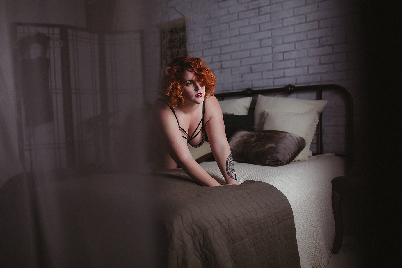orange-county-boudoir-photographer-sexy-crawl-across-bed-loft.jpg