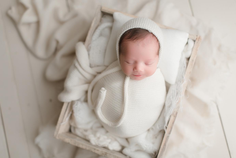 orange-county-newborn-photography-studio-irvine-california-all-white-set-white-wood-blankets-crate-baby-boy.jpg