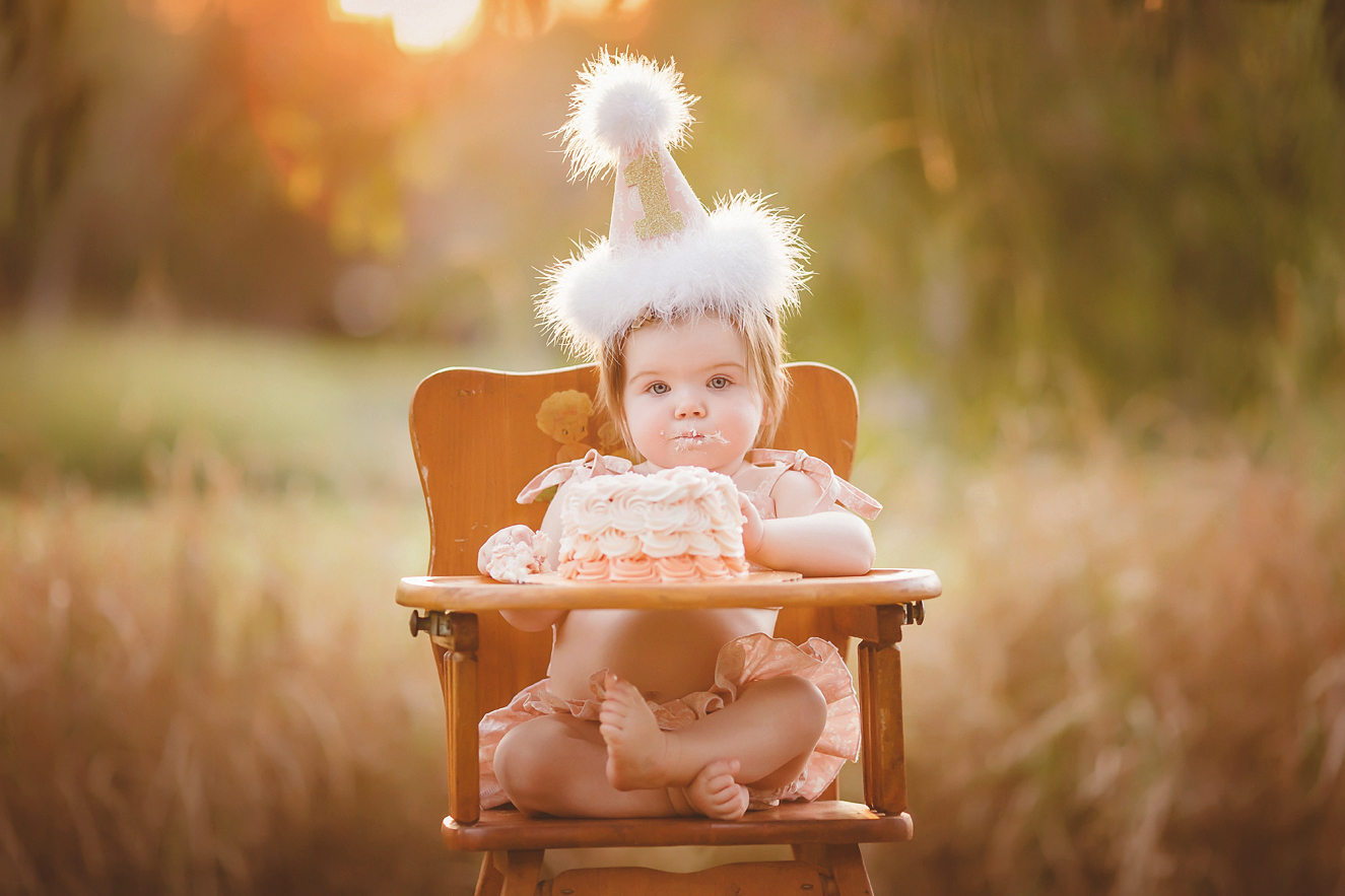 orange-county-first-birthday-photography-baby-girl-cake-smash-outdoor-vintage-high-chair.jpg
