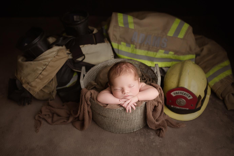 orange-county-newborn-photographer-irvine-studio-firefighter-baby-boy-dramatic-uniform.jpg