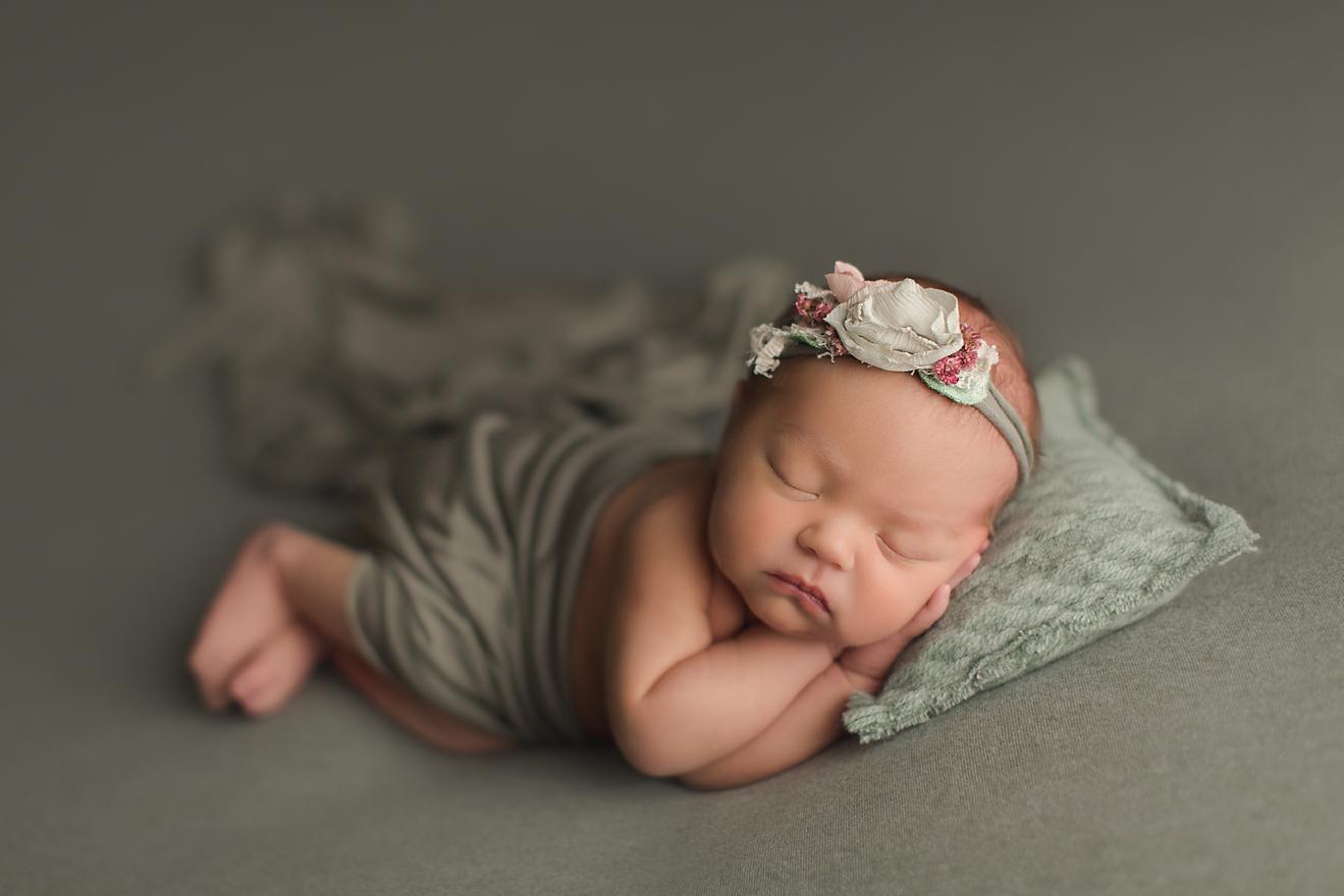 naturally-newborn-photography-orange-county-studio-baby-girl-sage-green-pillow.jpg
