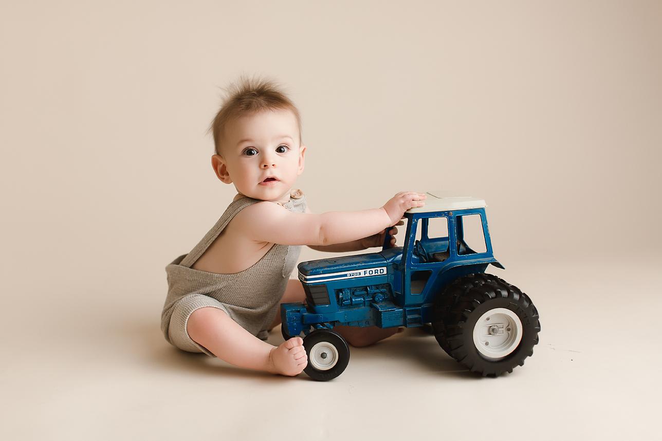 orange-county-baby-photography-studio-vintage-style-overalls-tractor-baby-boy.jpg