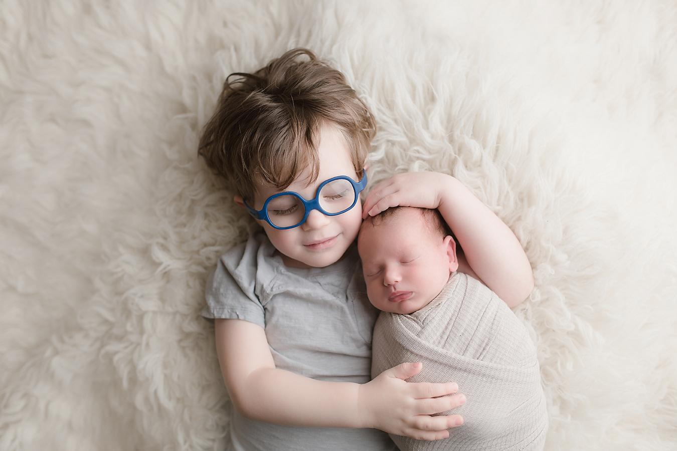 orange-county-newborn-photographer-irvine-studio-brothers-baby-boy-glasses.jpg