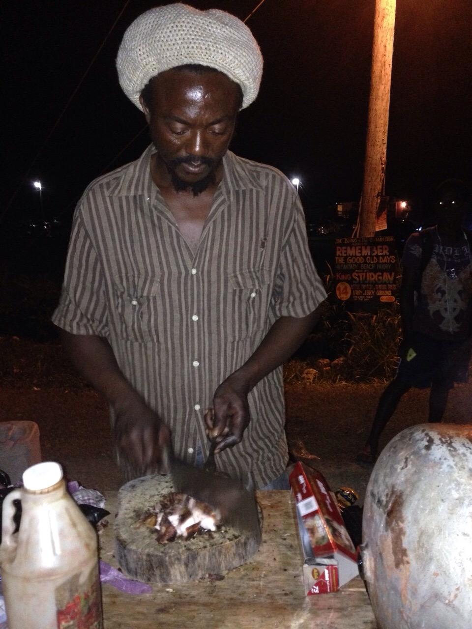 Jerk Chicken Man outside a street party
