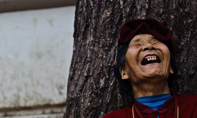 Laughing Tibetan Woman by   Francois de Halleux