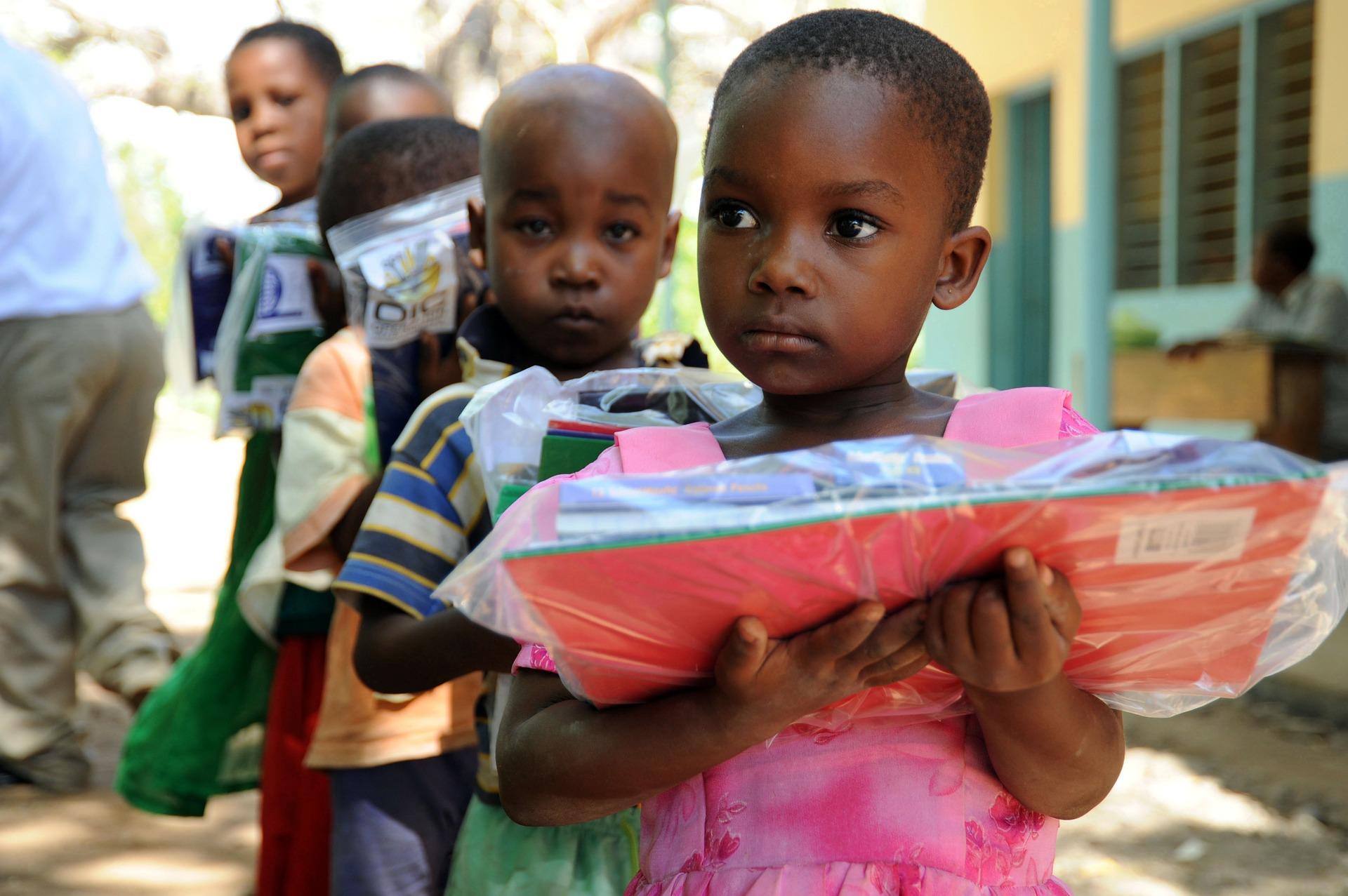 Tanzanian girl with books.jpg
