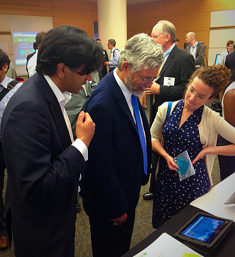 Carbon Visuals, Chief Operating Officer, Ravi Kapur in Washington at the Energy Datapoloza, May 28, 2014. Ravi is pictured with Dr. John Holdren, Director of the White House Office of Science and Technology Policy, watching our New York emissions video.