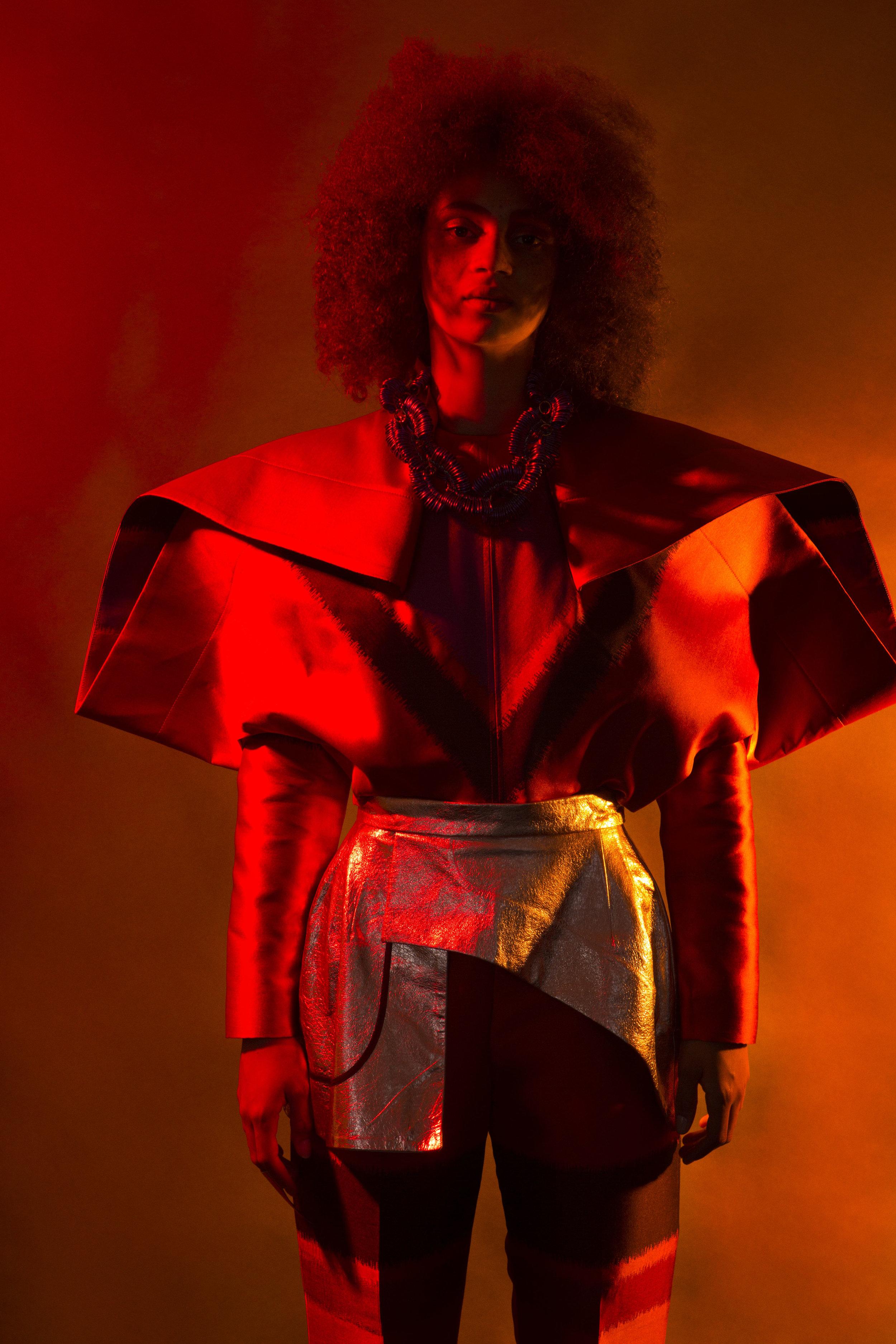 Jumpsuit: CIMONE, Skirt and Neckpiece: LONGSHAW WARD, Ring: EKRIA