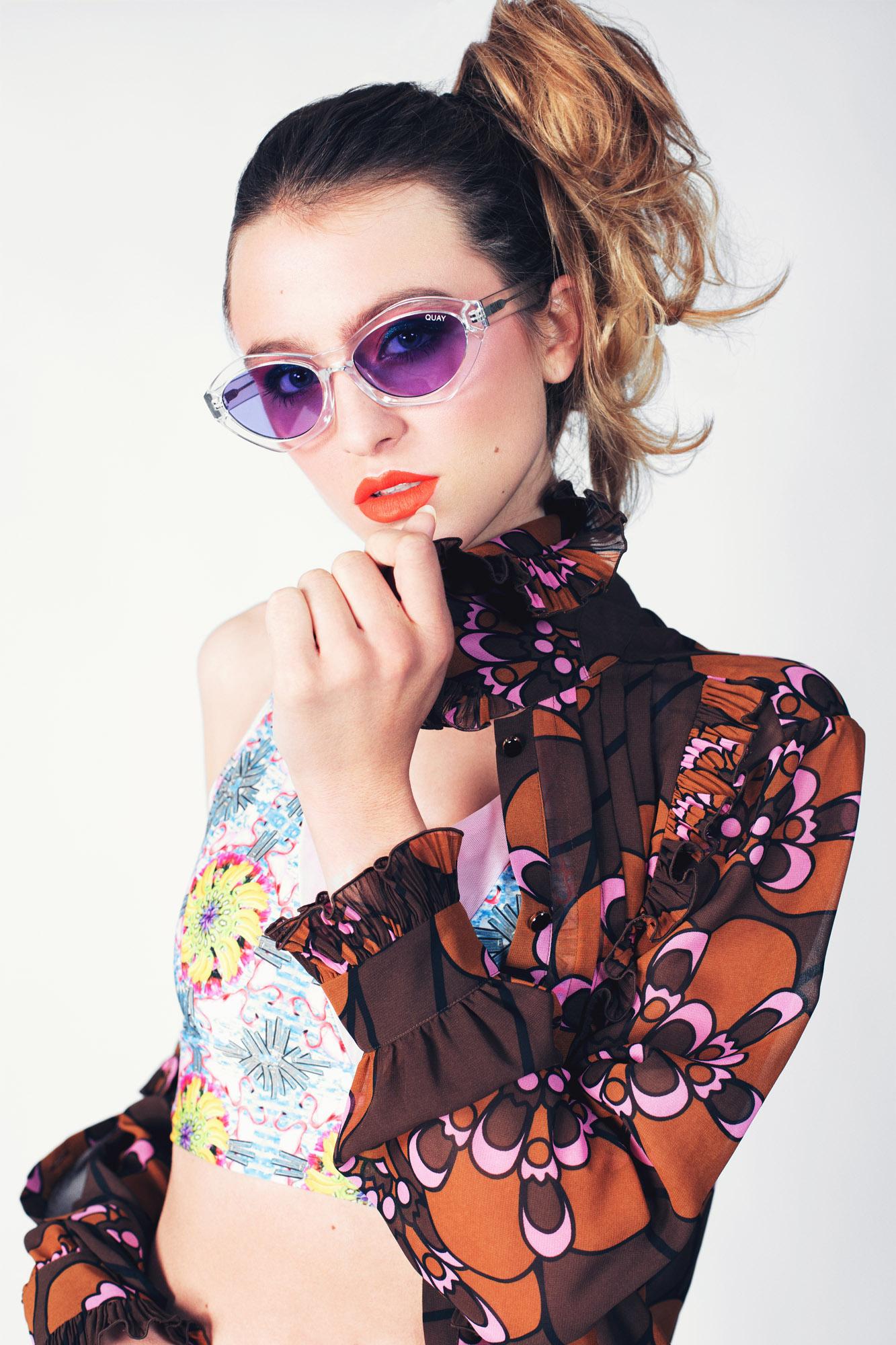 Phoebe Wright wears Crop Top: ADOSMANOS,Skirt: CAITLIN CHARLES-JONES, Shirt: ORLA KIELY,Sunglasses: QUAY AUSTRALIA, Neckpiece: CIVILIAN LONDON Heels: KIM WANG