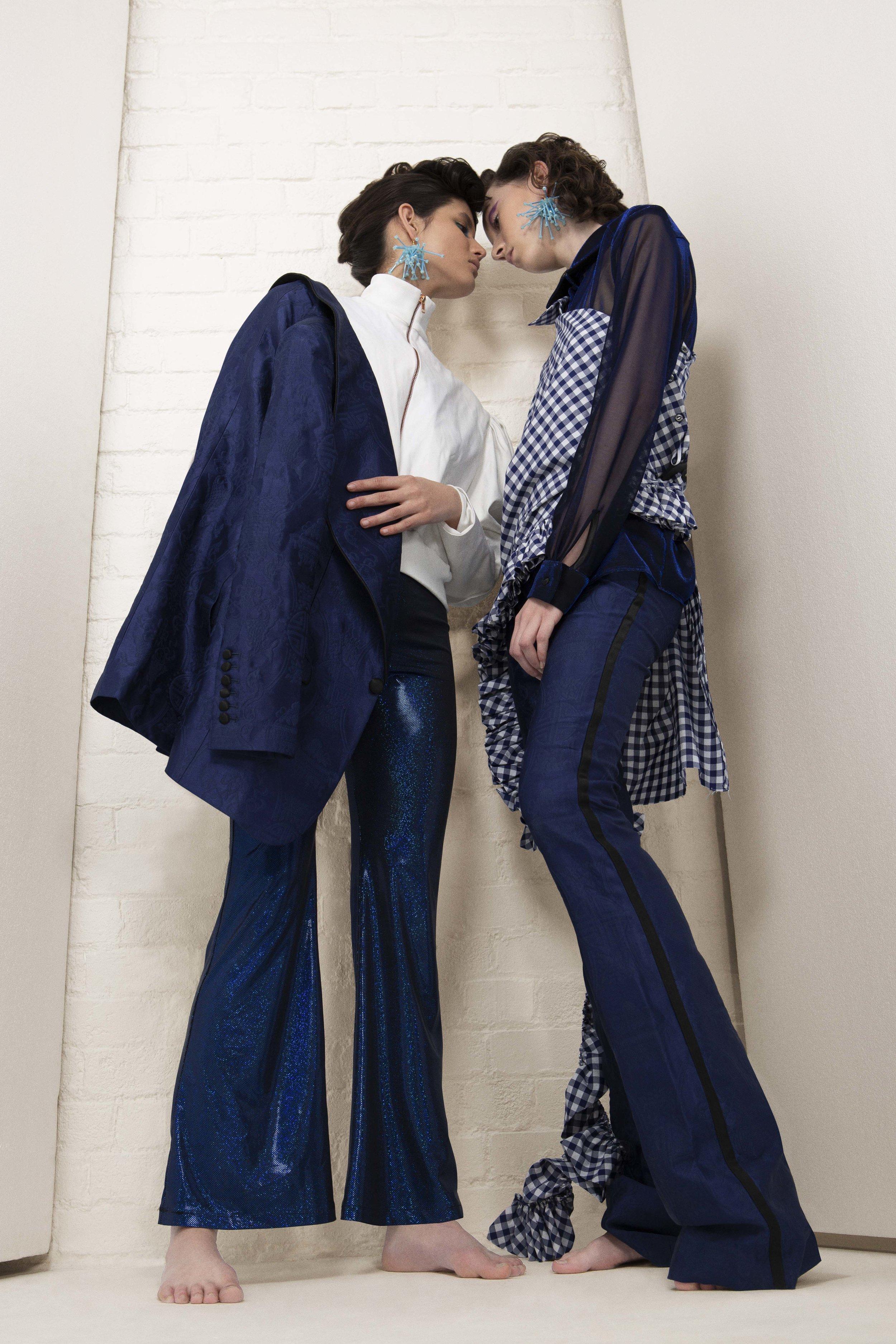Sara (Left) : Jacket – SADIE CLAYTON Blazer – MALAN BRETON Pants – ROKIT Earring – KRISTY WARD (YOUNG BRITISH DESIGNERS) Footwear – STINE GOYA    Anotonie (Right) : Shirt – TRAMP IN DISGUISE Top – LES ANIMAUX Pants – MALAN BRETON Earring – KRISTY WARD (YOUNG BRITISH DESIGNERS) Footwear – STINE GOYA