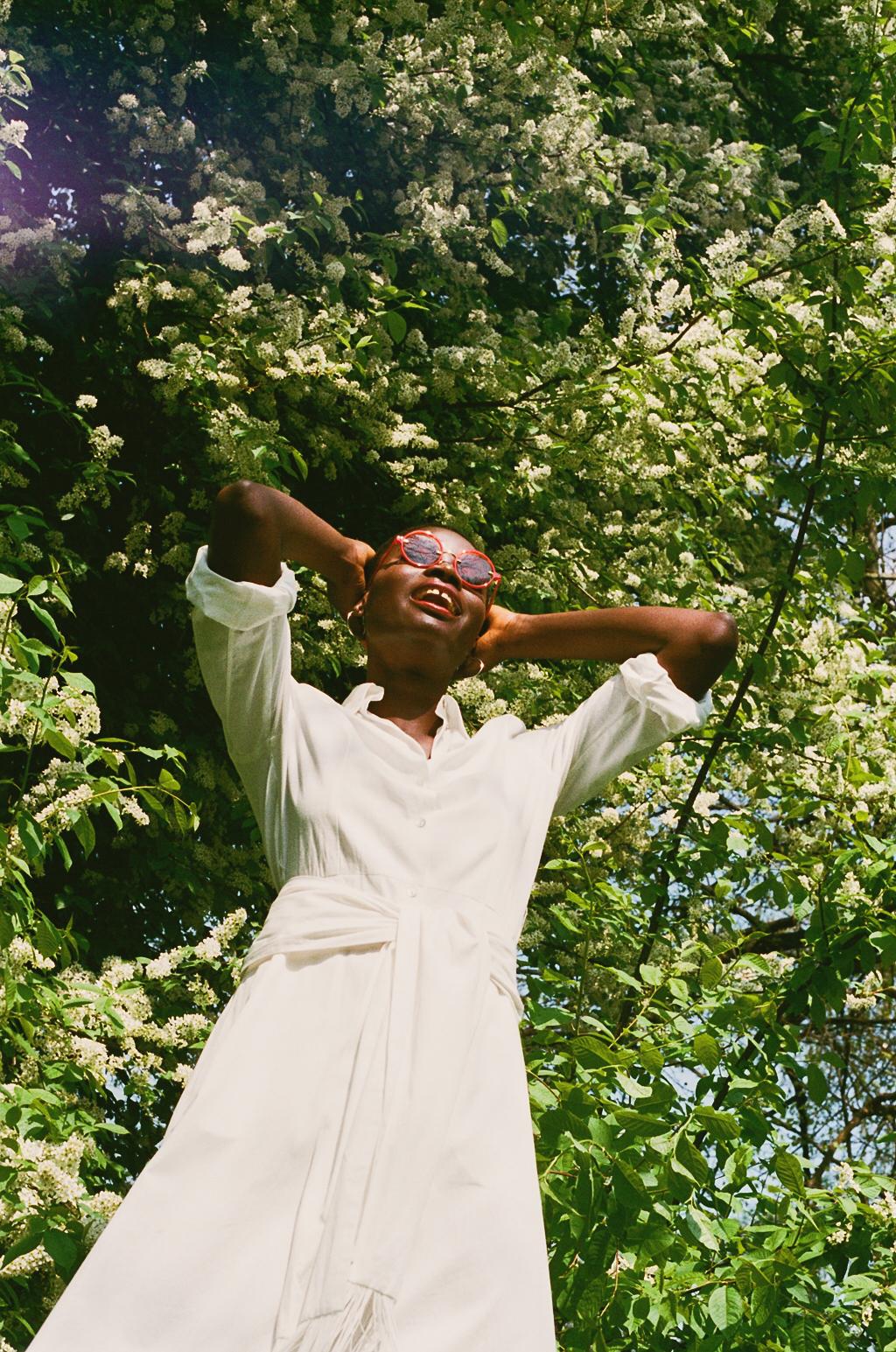 Earrings -Model's own  Sunglasses - Kaleos Eyehunters  Dress - Hillier Bartley