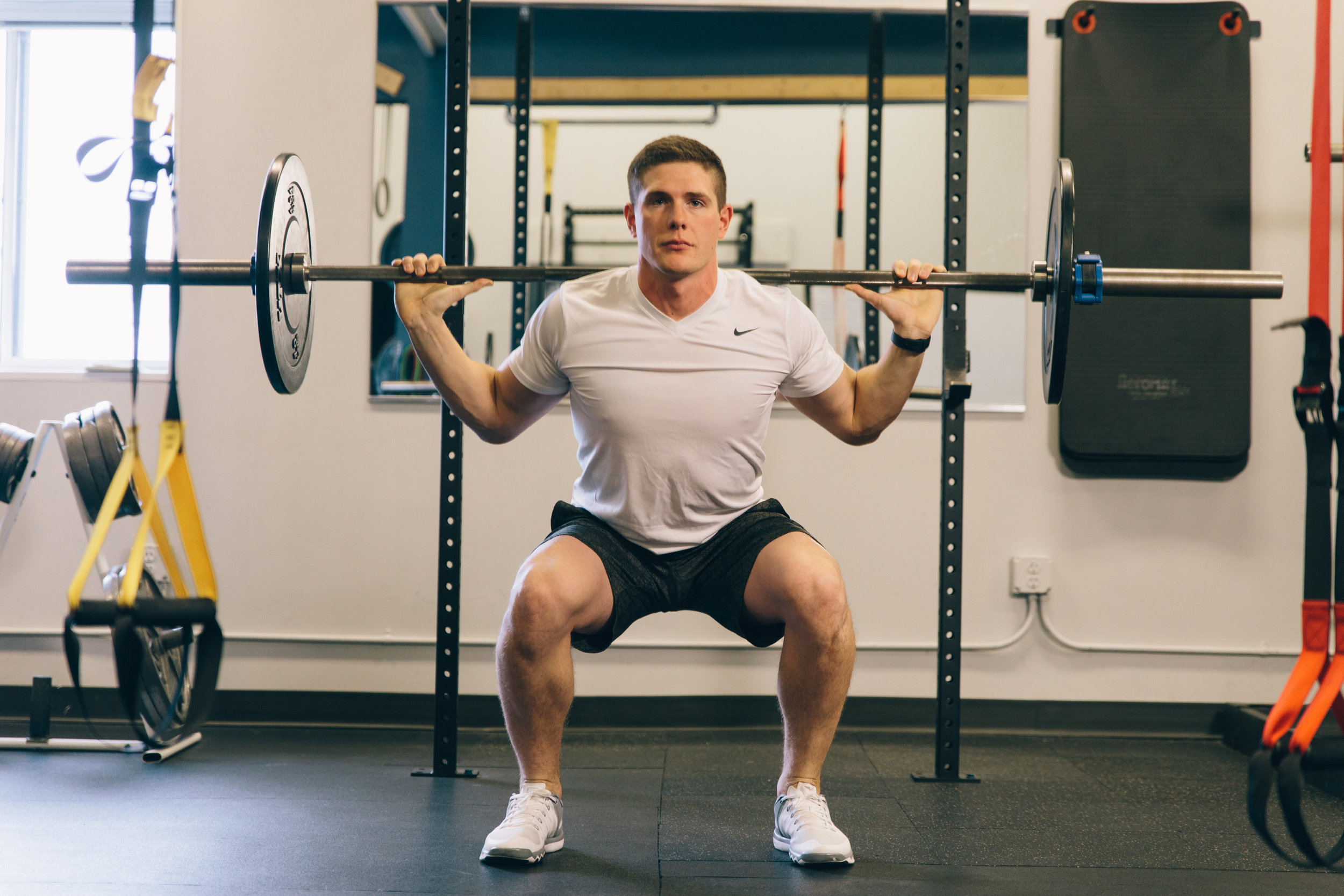 Pulse Podiatry Weight lifting barbell squat form