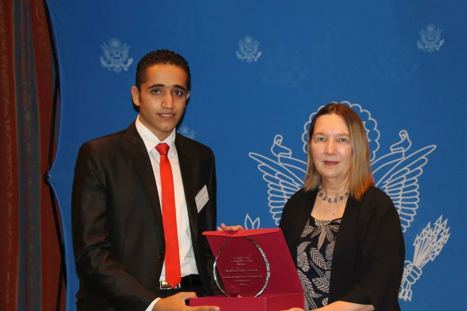 Ahmed receives an award by the US Embassy in Cairo