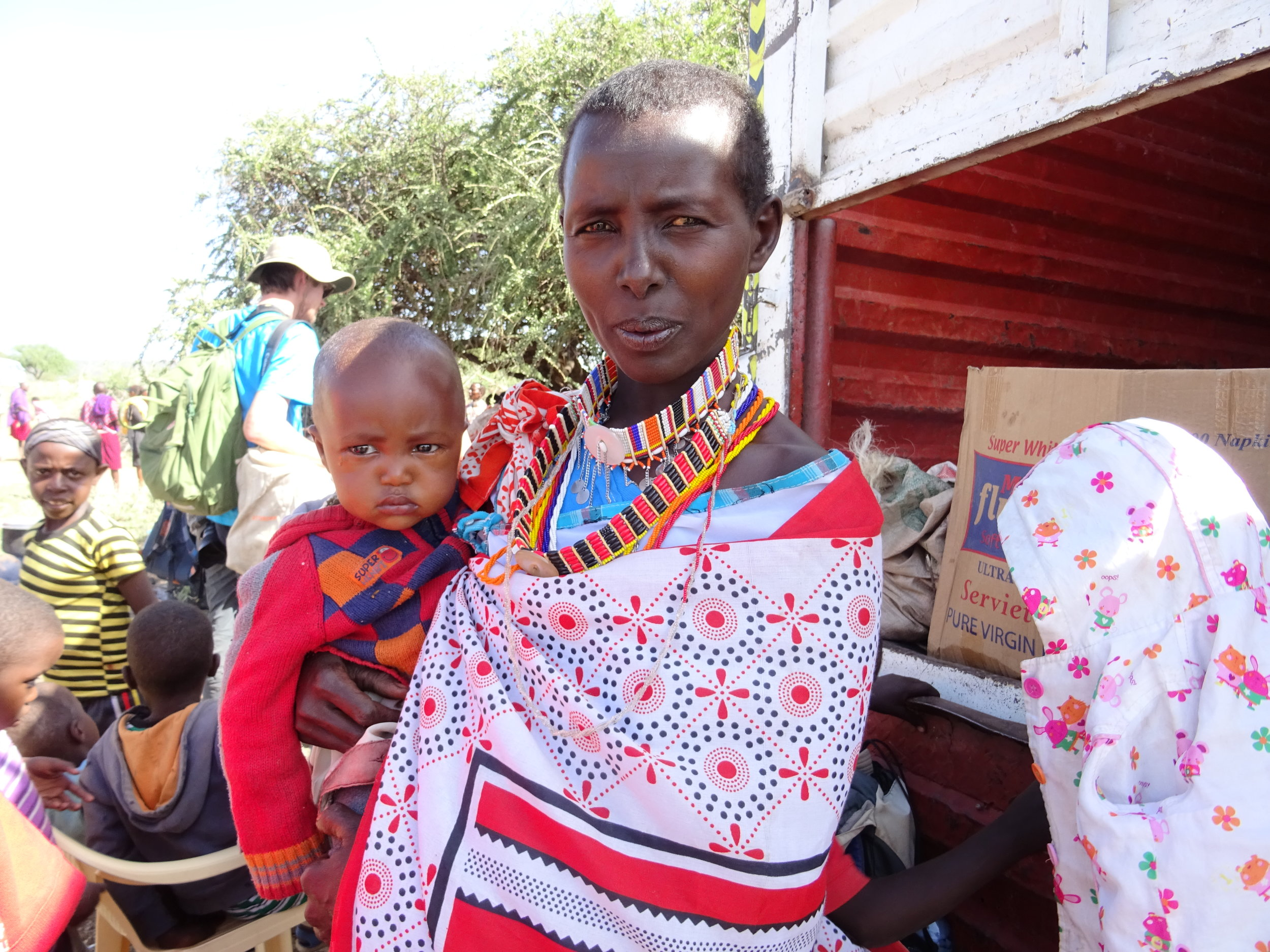 Maasai woman carrying water / Source: A Road Less Travelled