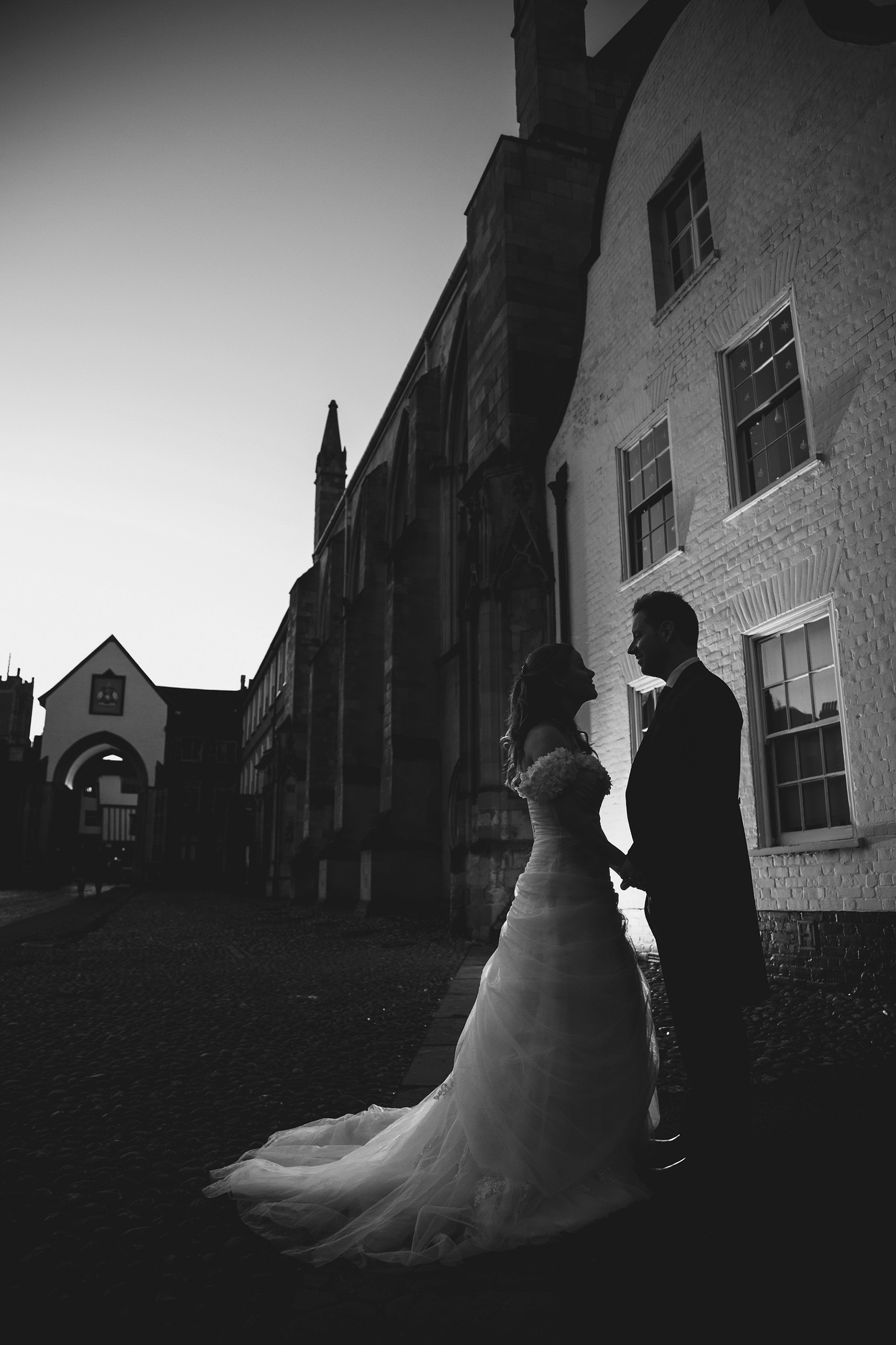 Kerri & Grant having their couples portraits in the very last of the daylight, before their night-time Castle wedding - Norwich