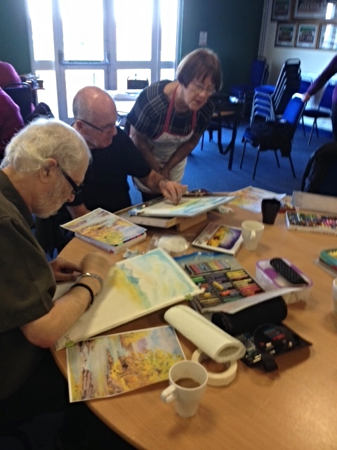 The group working on Ian's pastel workshop