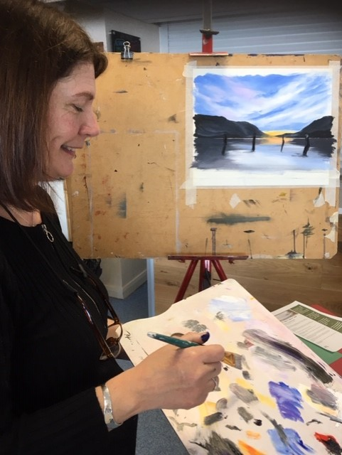 Deborah demonstrating how to paint with oils