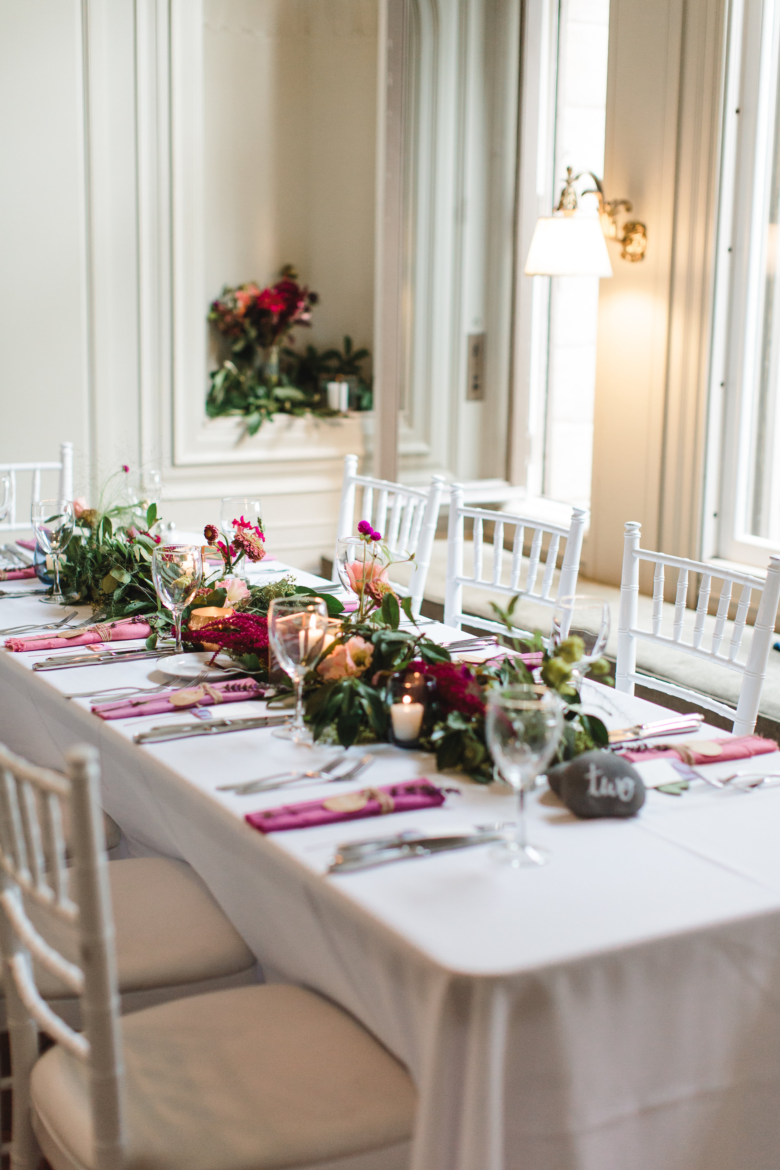 The reception featured many handmade touches; the bride hand dyed the napkins and did not shy away from gorgeous, saturated color. Photo by Emily Kirke Photography.