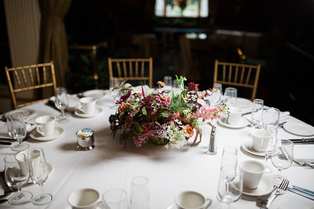 Lush centerpieces. Photo by RC Zajac Photography.