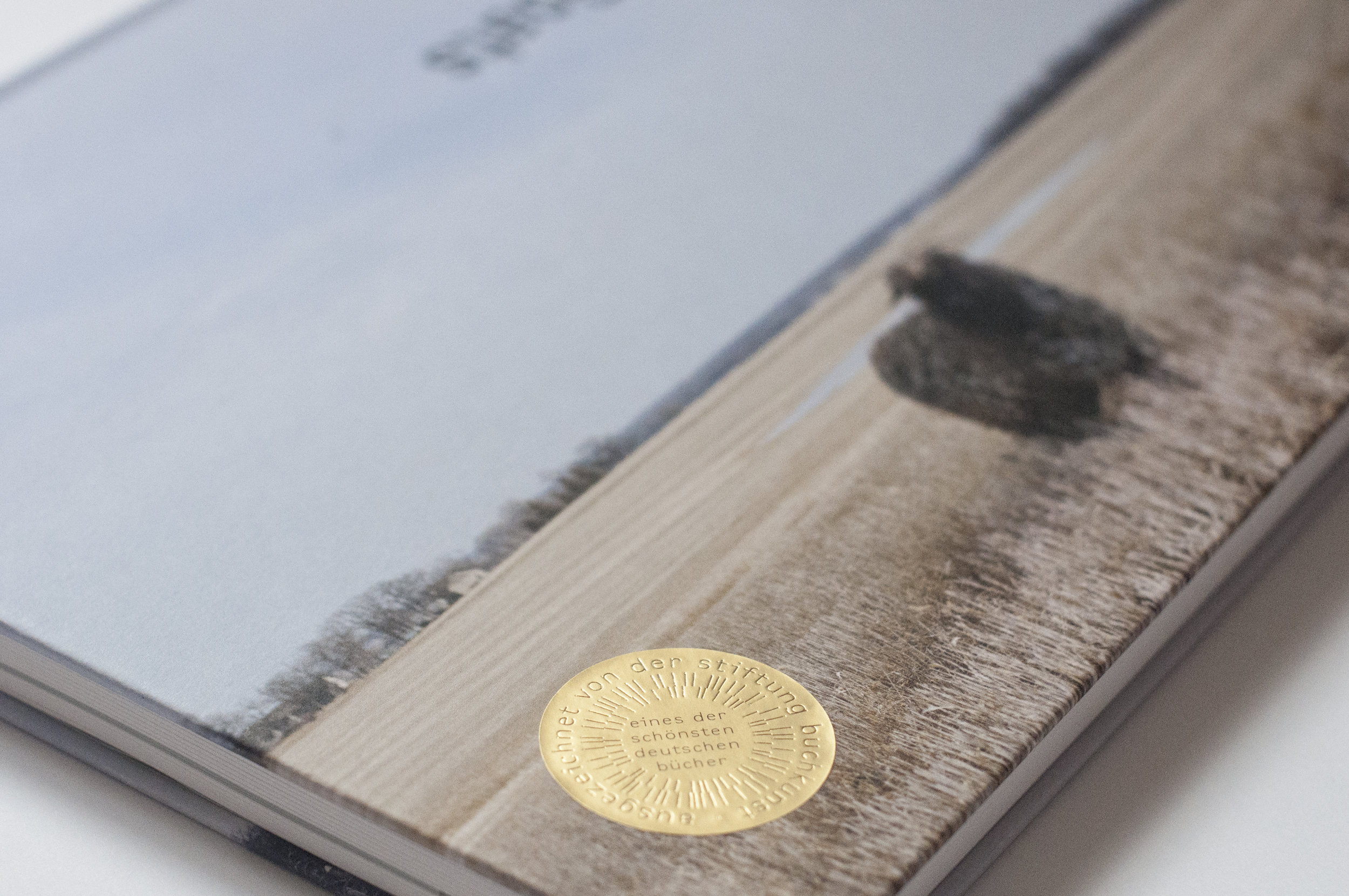 "The golden award sticker on ""The Sheep and the Goats"" monograph. Photo by Maximiliane Hüls  (designer)."