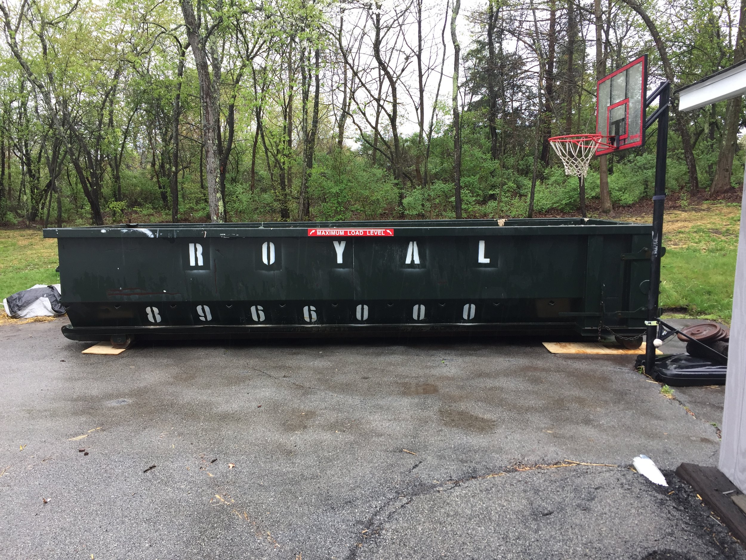 Dumpster arrives to start the process.jpeg