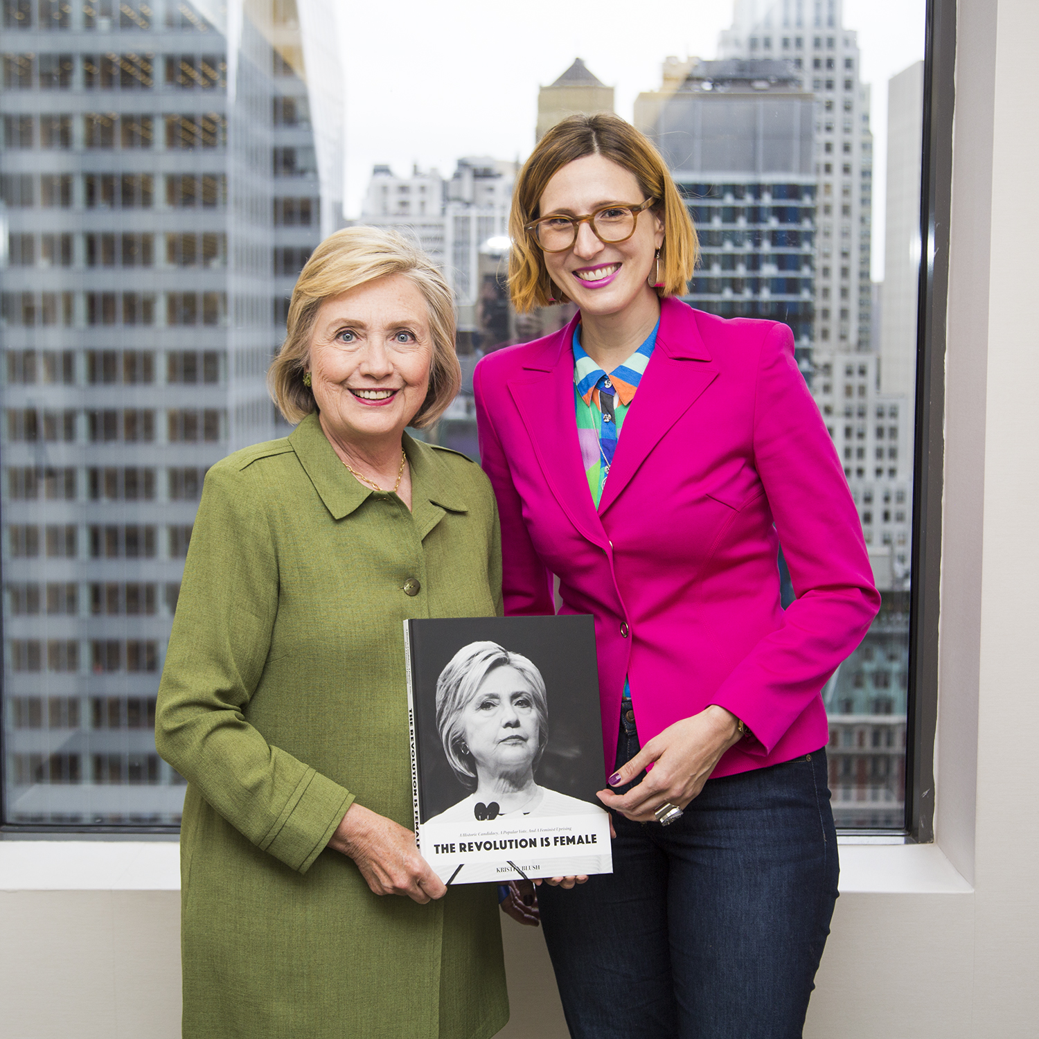 Hillary Rodham Clinton and photographer Kristen Blush pose with a copy of The Revolution Is Female. Photo by Nick Merrill, 2018.
