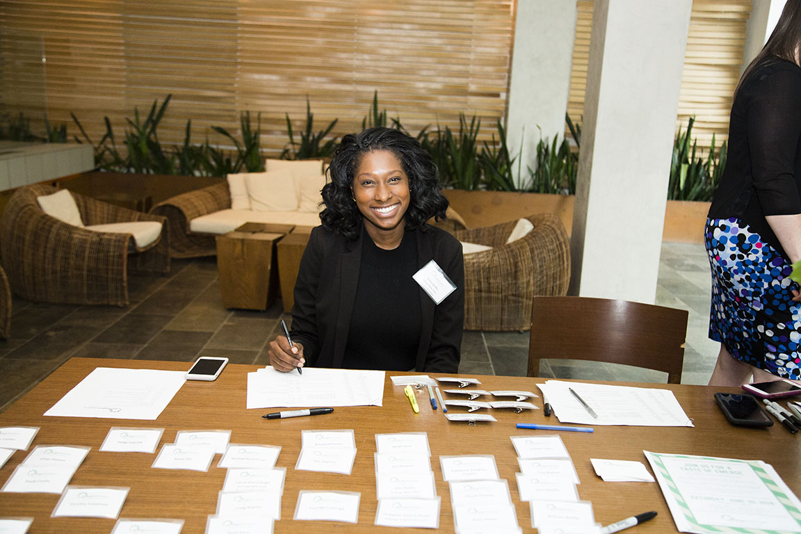Maria Griffon is checking in members at an Emerge America fundraiser with New York Attorney General Tish James and Danica Roem. New York, NY. 2018