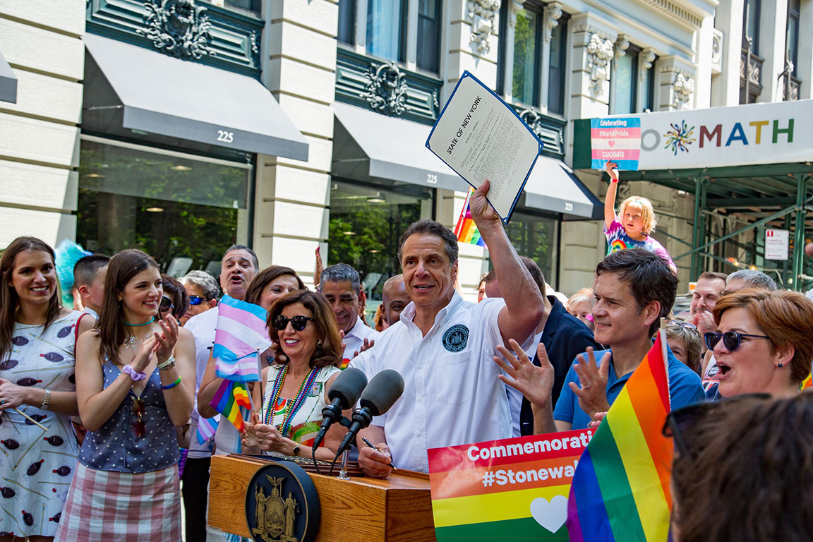 "Governor Cuomo signs Bill A2707 at the New York City Pride March on Sunday, banning the so-called ""gay panic"" defense in New York State, as elected officials and members from the LGBTQ cheered alongside him. Photo by Kristen Blush"